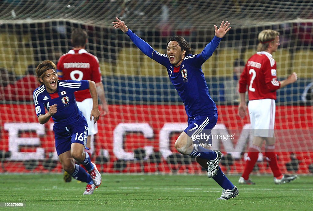 Yasuhito Endo of Japan celebrates scoring his team's second goal from a free kick with Yoshito Okubo during the 2010 FIFA World Cup South Africa...