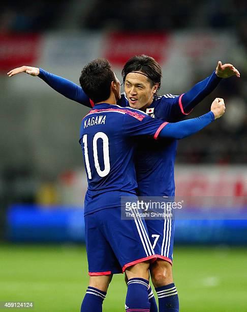 Yasuhito Endo of Japan celebrates scoring his team's third goal with his teammate Shinji Kagawa during the international friendly match between Japan...