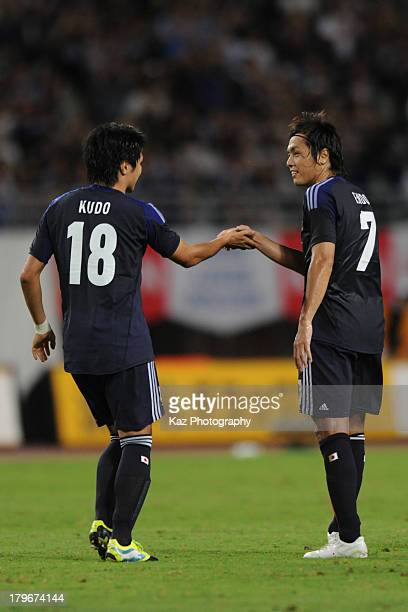 Yasuhito Endo of Japan is congratulated by Masato Kudo after scoring their team's third goal during the international friendly match between Japan...