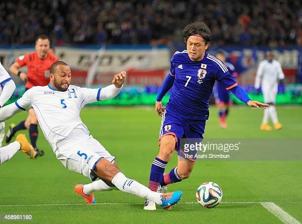 Yasuhito Endo of Japan is tackeld by Victor Bernardez of Honduras during the international friendly match between Japan and Honduras at Toyota...