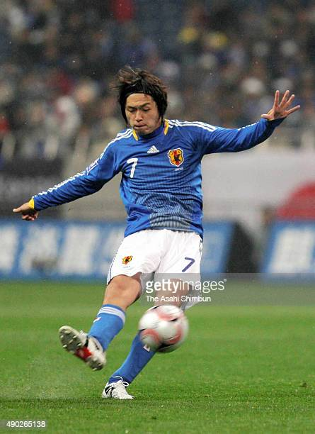 Yasuhito Endo of Japan scores his team's first goal during the FIFA World Cup South Africa Asian Qualifier match between Japan and Thailand at...