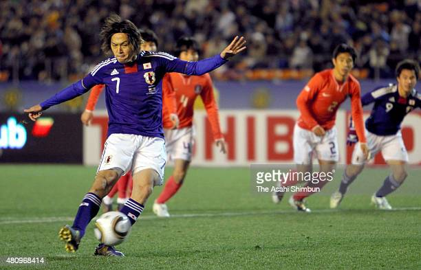 Yasuhito Endo of Japan scores his team's first goal from the penalty spot during the East Asian Football Championship match between Japan and South...