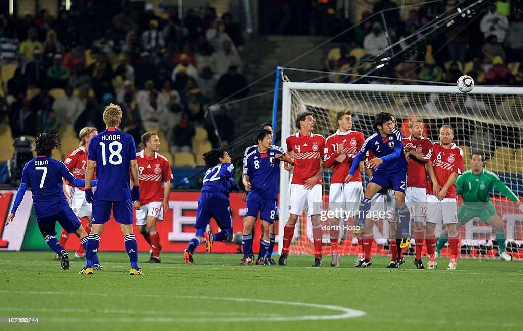 Yasuhito Endo of Japan scores his team's second goal from a free kick during the 2010 FIFA World Cup South Africa Group E match between Denmark and...