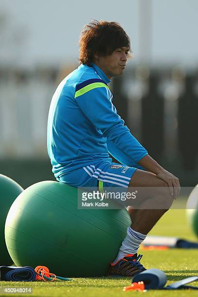 Yasuhito Endo sits on a ball as he waits for the start of the session during a Japan training session at the Japan national team base camp at the Spa...