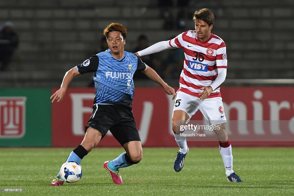 Yasuhito Morishima #9 of Kawasaki Frontale and ntony Golec #35 of Western Sydney Wanderers compete for the ball during the AFC Champions League Group H match between Kawasaki Frontale and Western Sydney Wanderers at Todoroki Stadium on April 1, 2014 in Kawasaki, Japan.