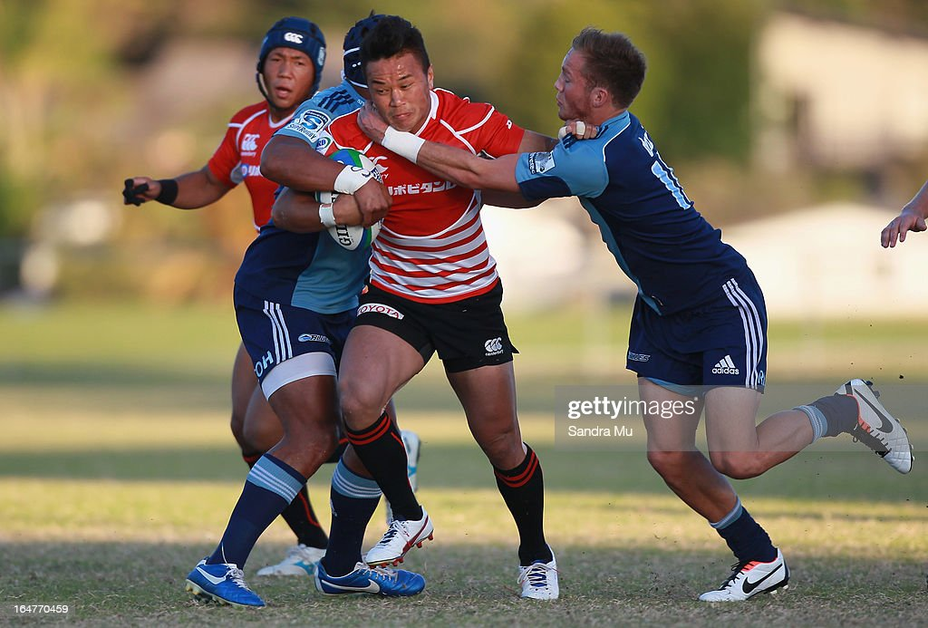 Yasuki Hayashi of Japan is tackled during the Pacific Rugby Cup match between the Blues Development and Junior Japan at Bell Park on March 28, 2013 in Auckland, New Zealand.