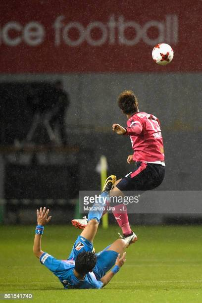 Yasuki Kimoto of Cerezo Osaka and Kim Min Hyeok of Sagan Tosu compete for the ball during the JLeague J1 match between Sagan Tosu and Cerezo Osaka at...