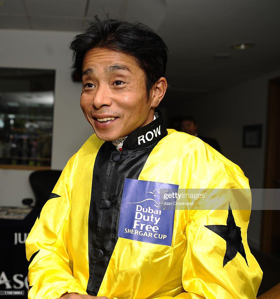 Yasunari Iwata poses at Ascot racecourse on August 10, 2013 in Ascot, England.