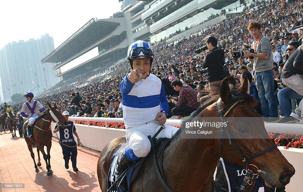 Yasunari Iwata riding Lord Kanaloa from Japan, celebrates after winning The Longines Hong Kong Sprint during the Hong Kong International Races at Sha Tin racecourse on December 9, 2012 in Hong Kong.