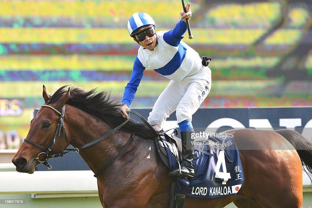 Yasunari Iwata riding Lord Kanaloa from Japan, celebrates winning The Longines Hong Kong Sprint during the Hong Kong International Races at Sha Tin racecourse on December 9, 2012 in Hong Kong.