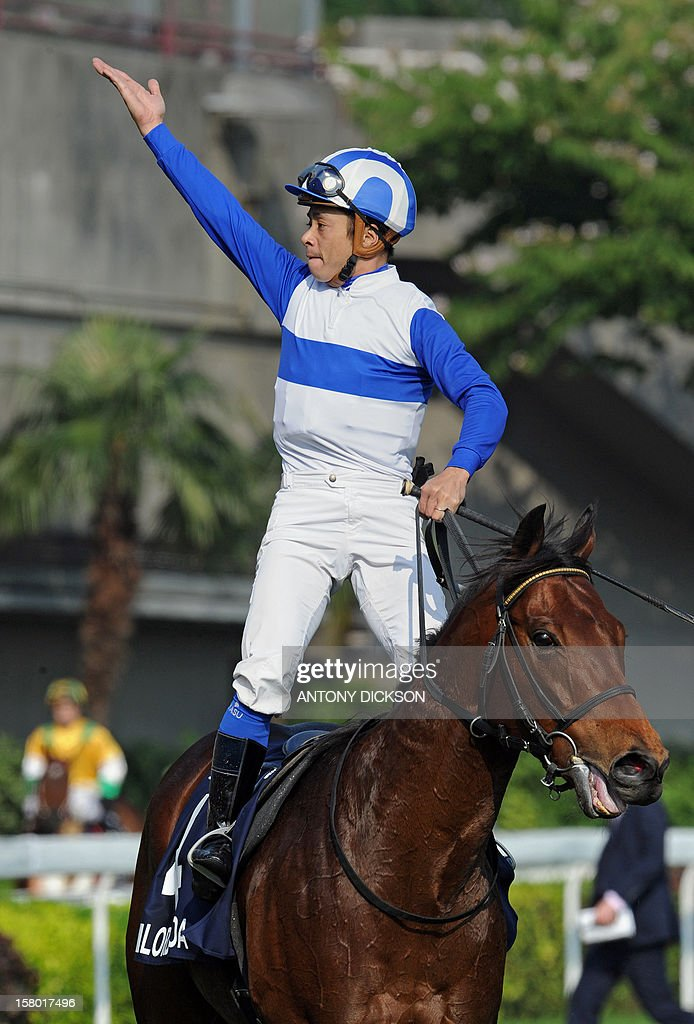 Yasunari Iwata riding Lord Kanoloa of Japan celebrates after riding to victory in the 1200-metre Longines Hong Kong Sprint race during the Hong Kong International Races at the Shatin racecourse in Hong Kong on December 9, 2012. The Sprint race is one of four Group One contests that are taking place at the Longines Hong Kong International Races with total prize money for the day at 9.2 million USD. AFP PHOTO / Antony DICKSON