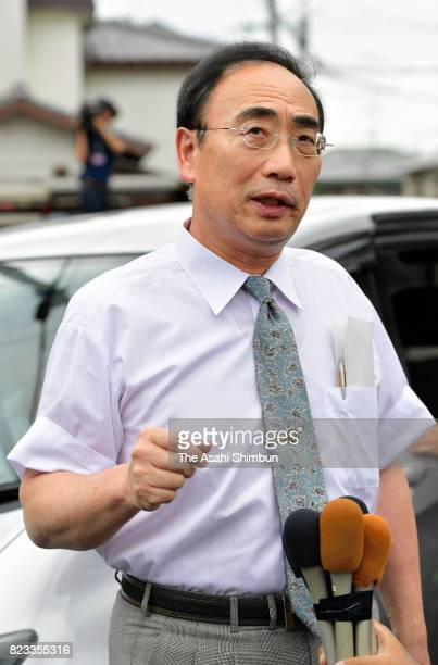 Yasunori Kagoike talks to reporters outside his home before going to speak with prosecutors on July 27 2017 in Toyonaka Osaka Japan Kagoike was the...