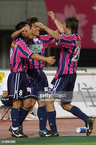 Yasuo Manaka of Cerezo Osaka celebrates scoring his team's first goal with his team mates Hiroaki Morishima and Akinori Nishizawa during the JLeague...