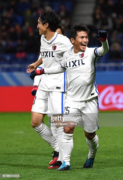 Yasushi Endo of Kashima Antlers celebrates scoring his sides second goal with team mates during the FIFA Club World Cup Semi Final match between...