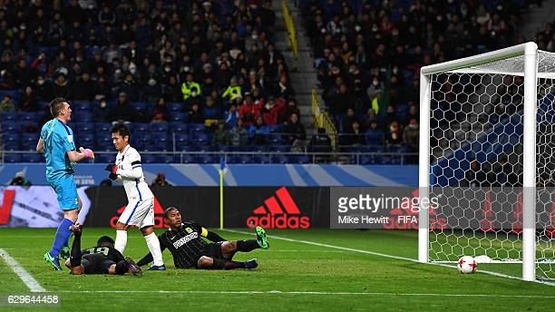 Yasushi Endo of Kashima Antlers scores his sides second goal during the FIFA Club World Cup Semi Final match between Atletico Nacional and Kashima...