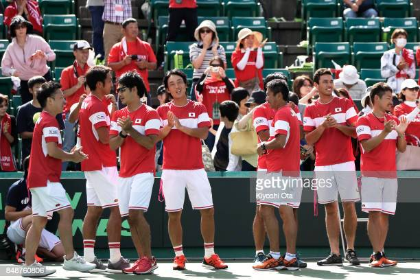 Yasutaka Uchiyama Go Soeda Ben McLachlan of Japan celebrate the team's 31 victory with team staff after Yuichi Sugita of Japan won his singles match...
