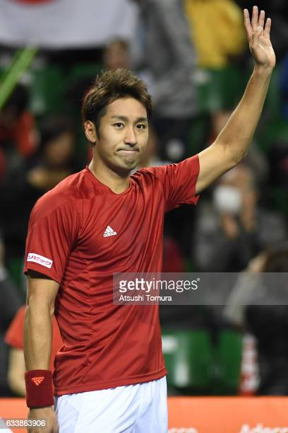 Yasutaka Uchiyama of Japan celebrates after winning the match against PierreHugues Herbert of France during the Davis Cup by BNP Paribas first round...
