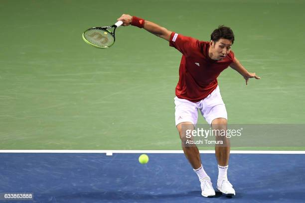 Yasutaka Uchiyama of Japan plays a backhand in his match against PierreHugues Herbert of France during the Davis Cup by BNP Paribas first round...