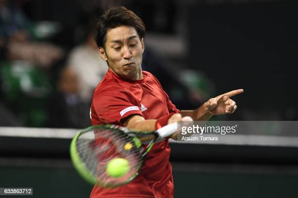 Yasutaka Uchiyama of Japan plays a forehand in his match against PierreHugues Herbert of France during the Davis Cup by BNP Paribas first round...