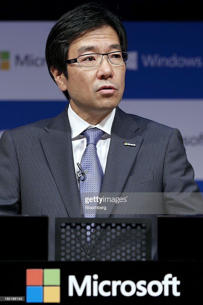 Yasuyuki Higuchi, president and chief executive officer of Microsoft Japan Co., speaks during a launch event for Microsoft Corp.'s Windows 8.1 operating system in Tokyo, Japan, on Friday, Oct. 18, 2013. Microsoft Chief Executive Officer Steve Ballmer, who will be retiring within a year, said the company is still working to make sure that the personal computer remains relevant as 'the device of choice.' Photographer: Kiyoshi Ota/Bloomberg via Getty Images