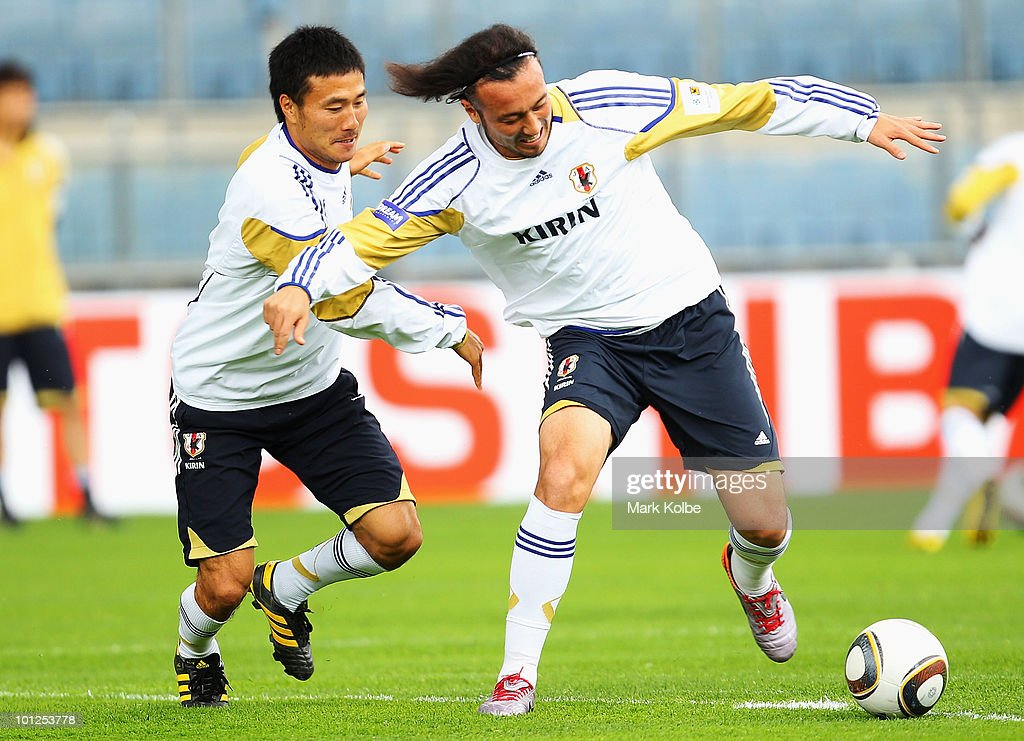 Yasuyuki Konno and Marcus Tulio Tanaka compete for the ball during a Japan training session at UPC-Arena on May 29, 2010 in Graz, Austria.