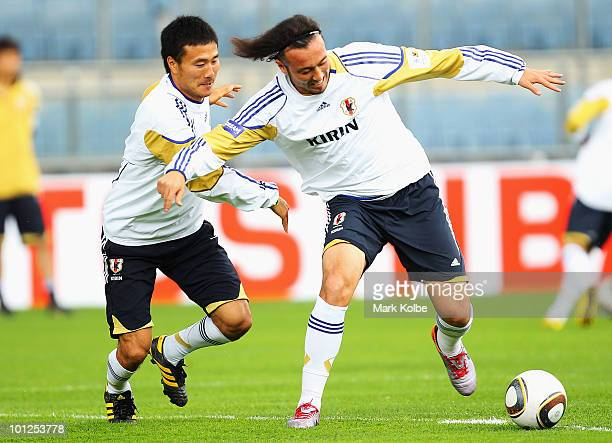 Yasuyuki Konno and Marcus Tulio Tanaka compete for the ball during a Japan training session at UPCArena on May 29 2010 in Graz Austria
