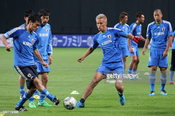 Yasuyuki Konno Daisuke Matsui Keisuke Honda and Takayuki Morimoto take part in the Japan national team training session ahead of the Kirin Challenge...