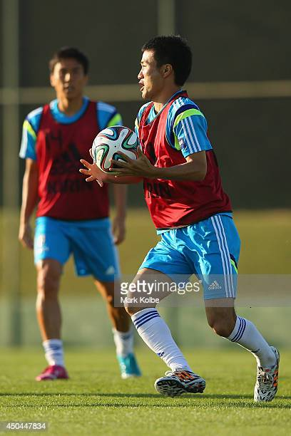 Yasuyuki Konno looks to pass during a drill at a Japan training session at the Japan national team base camp at the Spa Sport Resort on June 11 2014...