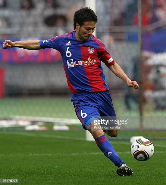 Yasuyuki Konno of FC Tokyo kicks during the JLeague match between FC Tokyo and Yokohama F Marinos at Ajinomoto Stadium on March 6 2010 in Tokyo Japan