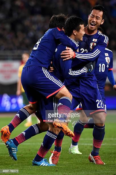 Yasuyuki Konno of Japan celebrates his opener with Maya Yoshida of Japan during the international friendly match between Japan and Australia at Nagai...