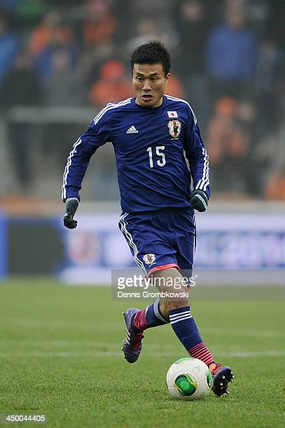Yasuyuki Konno of Japan controls the ball during the International Friendly match between the Netherlands and Japan on November 16 2013 in Genk...