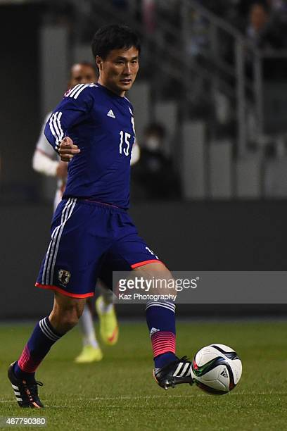 Yasuyuki Konno of Japan passes the ball during the international friendly match between Japan and Tunisia at Oita Bank Dome on March 27 2015 in Oita...