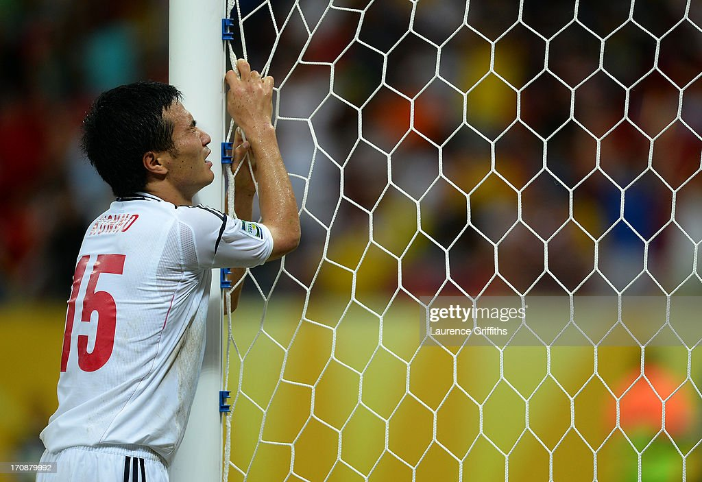 Yasuyuki Konno of Japan reacts after his team conceded a fourth goal during the FIFA Confederations Cup Brazil 2013 Group A match between Italy and Japan at Arena Pernambuco on June 19, 2013 in Recife, Brazil.
