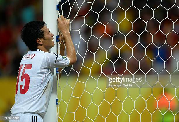 Yasuyuki Konno of Japan reacts after his team conceded a fourth goal during the FIFA Confederations Cup Brazil 2013 Group A match between Italy and...