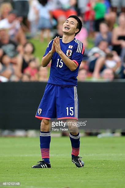 Yasuyuki Konno of Japan reacts after missing a shot at goal during the Asian Cup practice match between Japan and Auckland City on January 4 2015 in...
