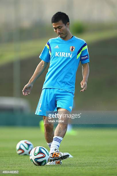 Yasuyuki Konno passes during a Japan training session at the Japan national team base camp at the Spa Sport Resort on June 11 2014 in Itu Sao Paulo