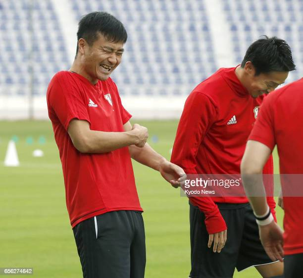 Yasuyuki Konno smiles during a Japan national soccer team training session in Al Ain the United Arab Emirates on March 21 prior to a finalround World...