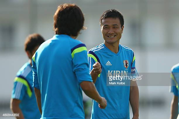 Yasuyuki Konno speaks to Yasuhito Endo during a Japan training session at the Japan national team base camp at the Spa Sport Resort on June 9 2014 in...