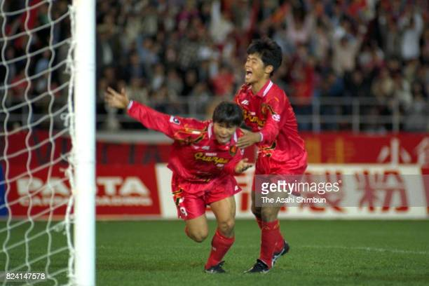 Yasuyuki Moriyama of Nagoya Grampus Eight celebrates scoring the vgoal with his team mate Takafumi Ogura during the JLeague match between Nagoya...