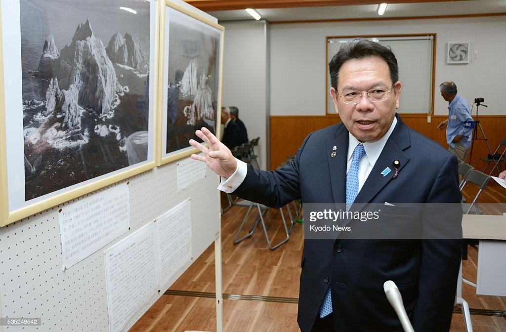 Yasuyuki Sakai, a parliamentary secretary in Japan's Cabinet Office, visits the Kumi Takeshima History Museum devoted to South Korea-controlled islets claimed by Japan on May 29, 2016, ahead of its June 1 opening. The Sea of Japan islets are called Dokdo in South Korea and Takeshima in Japan.