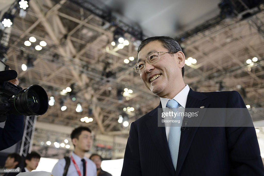 Yasuyuki Yoshinaga, president and chief executive officer of Fuji Heavy Industries Ltd., speaks during an interview at the 43rd Tokyo Motor Show 2013 in Tokyo, Japan, on Wednesday, Nov. 20, 2013. Yoshinaga said the company was looking to strengthen it's environmentally-friendly technologies partnership with Toyota. Photographer: Akio Kon/Bloomberg via Getty Images