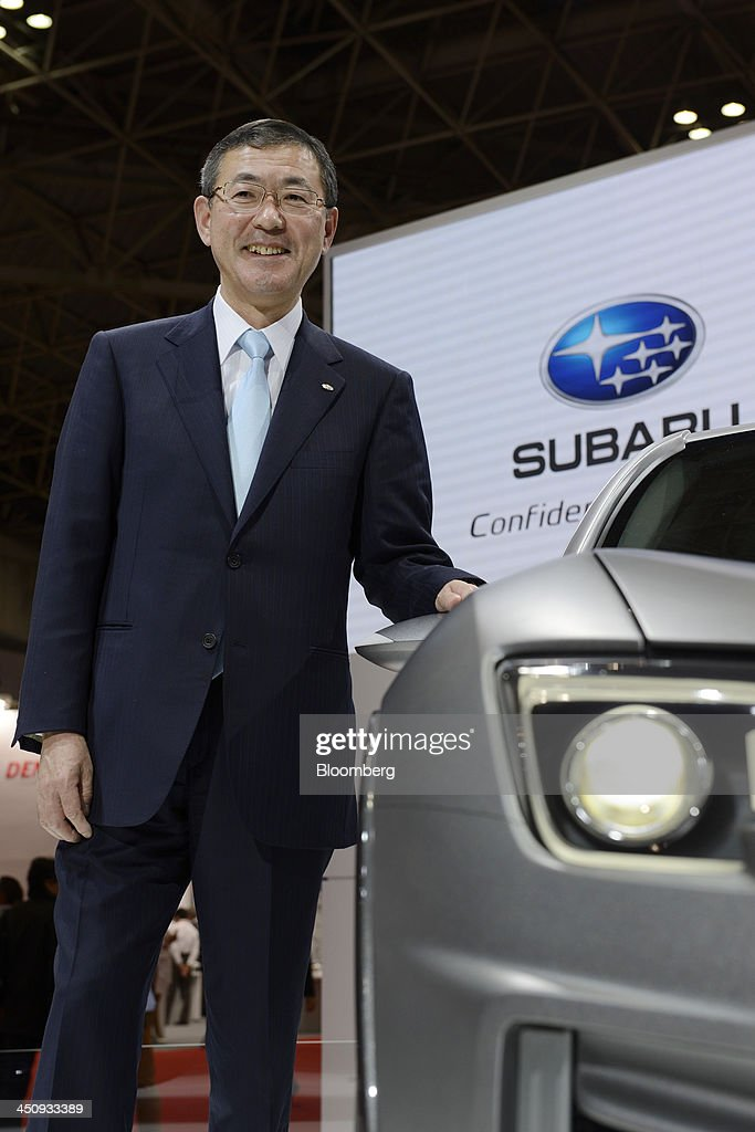 Yasuyuki Yoshinaga, president and chief executive officer of Fuji Heavy Industries Ltd., poses next to the company's Subaru Cross Sport Design Concept vehicle at the 43rd Tokyo Motor Show 2013 in Tokyo, Japan, on Wednesday, Nov. 20, 2013. Yoshinaga said the company was looking to strengthen it's environmentally-friendly technologies partnership with Toyota. Photographer: Akio Kon/Bloomberg via Getty Images