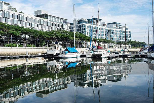 Yatchs and boats sit moored at the public marina at UEM Sunrise Bhd's Puteri Harbour residential and commercial development in Nusajaya Johor...