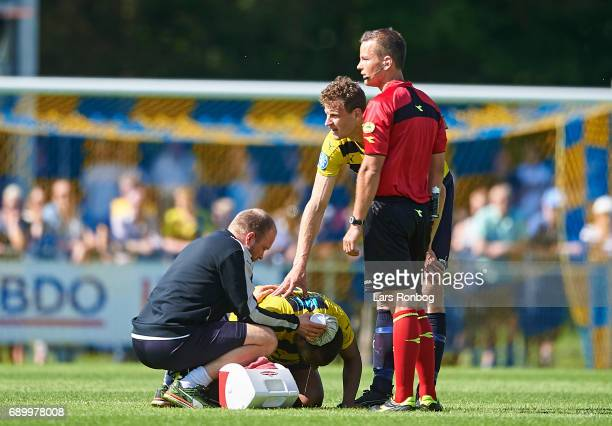 Yaw Amankwah of Hobro IK injured on the pitch during the Danish NordicBet LIGA 1 division match between Hobro IK and FC Vendsyssel at DS Arena on May...