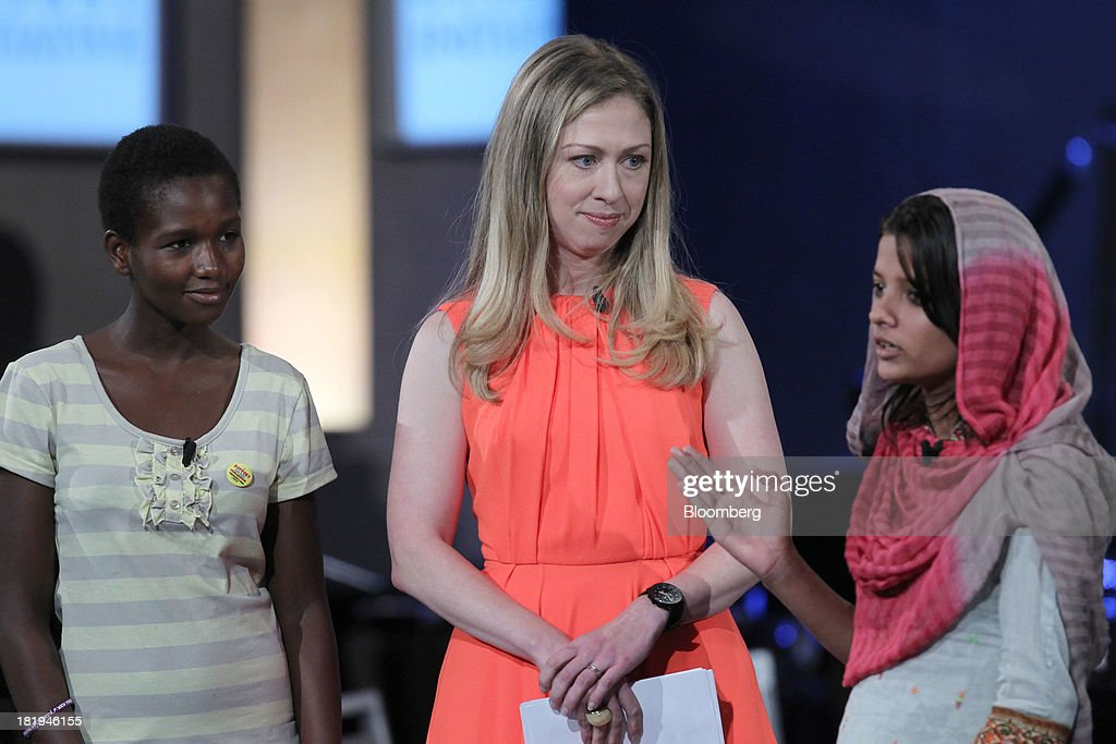 Yaweta Chavula, of Nairobi, from left, and <a gi-track='captionPersonalityLinkClicked' href=/galleries/search?phrase=Chelsea+Clinton&family=editorial&specificpeople=119698 ng-click='$event.stopPropagation()'>Chelsea Clinton</a>, daughter of former U.S. President Bill Clinton , listens while Laiba Shahzadi, of Pakistan, speaks during the annual meeting of the Clinton Global Initiative (CGI) in New York, U.S., on Thursday, Sept. 26, 2013. CGI's 2013 theme, mobilizing for impact, explores ways that members and organizations can be more effective in leveraging individuals, partner organizations, and key resources in their commitment efforts. Photographer: Jin Lee/Bloomberg via Getty Images
