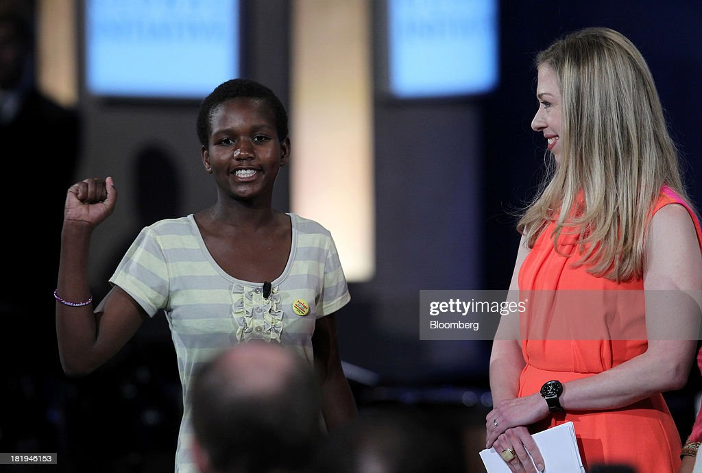 Yaweta Chavula, of Nairobi, left, speaks while <a gi-track='captionPersonalityLinkClicked' href=/galleries/search?phrase=Chelsea+Clinton&family=editorial&specificpeople=119698 ng-click='$event.stopPropagation()'>Chelsea Clinton</a>, daughter of former U.S. President Bill Clinton, listens during the annual meeting of the Clinton Global Initiative (CGI) in New York, U.S., on Thursday, Sept. 26, 2013. CGI's 2013 theme, mobilizing for impact, explores ways that members and organizations can be more effective in leveraging individuals, partner organizations, and key resources in their commitment efforts. Photographer: Jin Lee/Bloomberg via Getty Images
