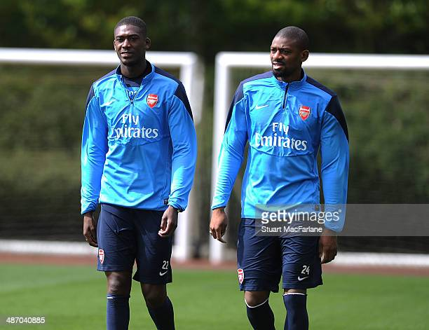 Yaya Sanogo and Abou Diaby of Arsenal before a training session at London Colney on April 27 2014 in St Albans England