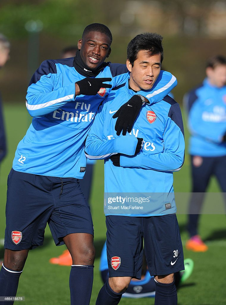 <a gi-track='captionPersonalityLinkClicked' href=/galleries/search?phrase=Yaya+Sanogo&family=editorial&specificpeople=5862550 ng-click='$event.stopPropagation()'>Yaya Sanogo</a> and Ju Young Park of Arsenal during a training session at London Colney on January 27, 2014 in St Albans, England.