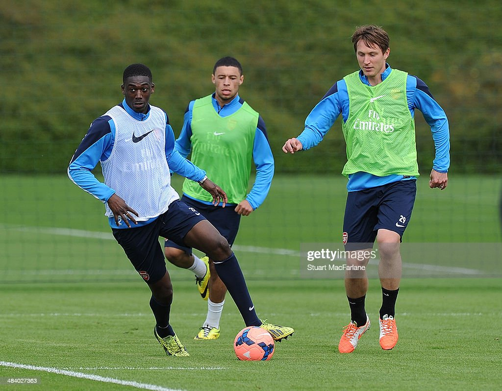 Yaya Sanogo and Kim Kallstrom of Arsenal during a training session at London Colney on April 11, 2014 in St Albans, England.