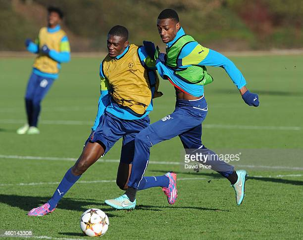 Yaya Sanogo and Semi Ajayi of Arsenal wrestle for the ball during the 1st team training session at London Colney on December 8 2014 in St Albans...